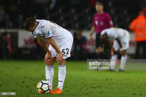 Swansea City's Welsh defender Connor Roberts reacts following the English Premier League football match between Swansea City and Southampton at The...