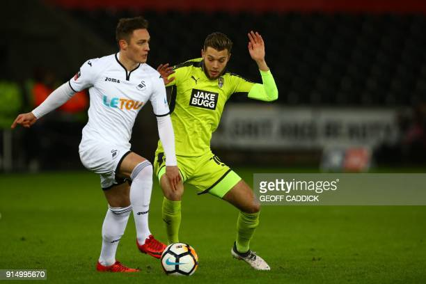 Swansea City's Welsh defender Connor Roberts vies with Notts County's English midfielder Jorge Grant during the English FA Cup fourth round replay...
