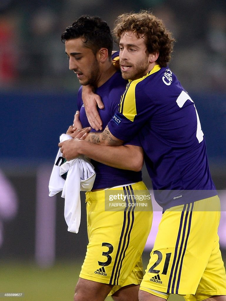 Swansea City's Welsh defender Neil Taylor (L) and Swansea City's Spanish midfielder Jose Alberto Canas celebrate at the end of the Europa League Group A football match between FC St Gallen and Swansea City on December 12, 2013 at the AFG Arena in St Gallen. Swansea lost 1-0.