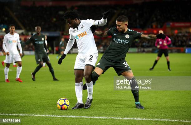 Swansea City's Wilfried Bony and Manchester City's Nicolas Otamendi battle for the ball during the Premier League match at the Liberty Stadium Swansea