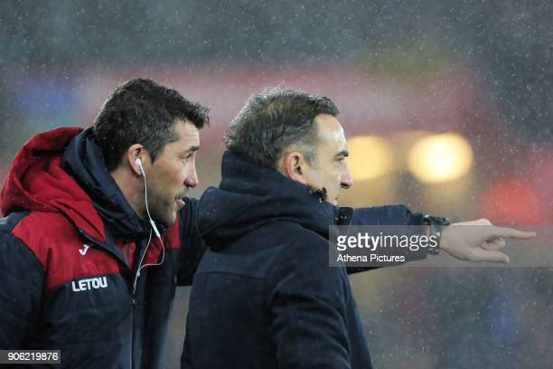 Swansea coach Bruno Lage speaks to manager Carlos Carvalhal on the touch line during the Emirates FA Cup match between Swansea and Wolverhampton...