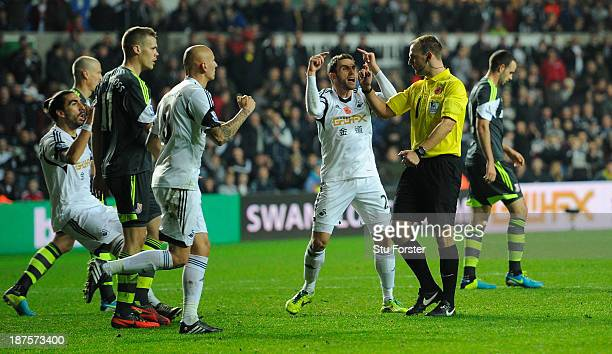 Swansea defender Angel Rangel reacts after referee Robert Madley had given Stoke a last minute penalty during the Barclays Premier League match...