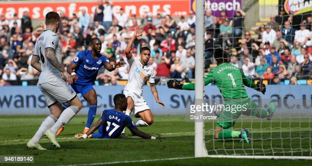 Swansea defender Kyle Naughton scores an own goal to put Everton in the lead during the Premier League match between Swansea City and Everton at...