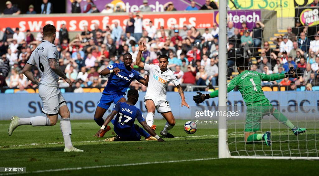 Swansea defender Kyle Naughton (2nd r) scores an own goal to put Everton in the lead during the Premier League match between Swansea City and Everton at Liberty Stadium on April 14, 2018 in Swansea, Wales.