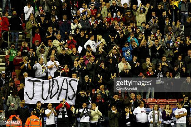 Swansea fans display a banner directed at Wigan Athletic Manager Roberto Martinez during the Carling Cup Fourth round match between Wigan Athletic...