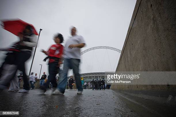 Swansea fans making their way from the stadium in the rain after the Npower Championship playoff final between Reading and Swansea City at Wembley...