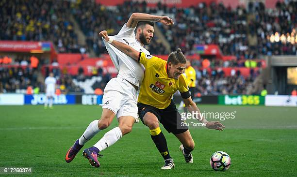 Swansea forward Borja challenges Watford defender Sebastian Prodl for the ball during the Premier League match between Swansea City and Watford at...