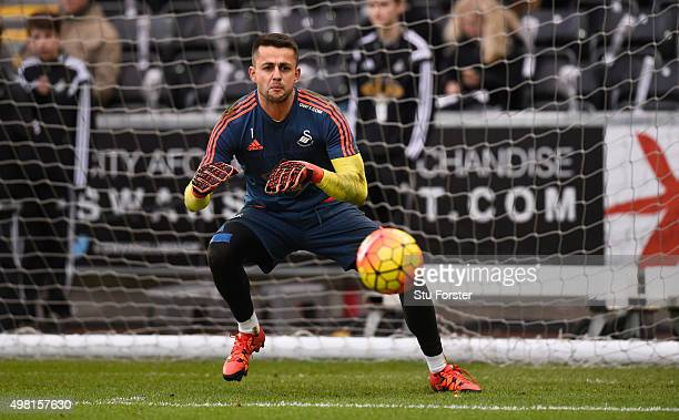 Swansea goalkeeper Lukasz Fabianski in action during the warm up before the Barclays Premier League match between Swansea City and A.F.C. Bournemouth...