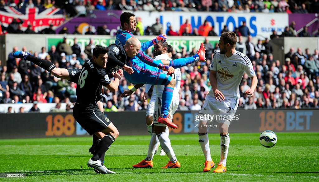 Swansea goalkeeper Lukasz Fabianski (c) is challenged by Steven Naismith and Gareth Barry (l) of Everton during the Barclays Premier League match between Swansea City and Everton at Liberty Stadium on April 11, 2015 in Swansea, Wales.