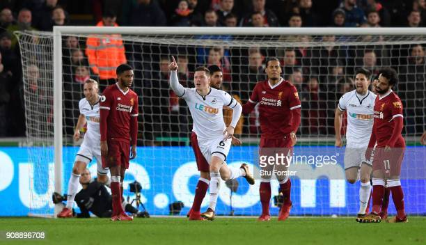 Swansea goalscorer Alfie Mawson celebrates the opening goal during the Premier League match between Swansea City and Liverpool at Liberty Stadium on...