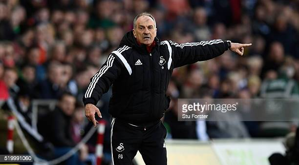 Swansea head coach Francesco Guidolin reacts during the Barclays Premier League match between Swansea City and Chelsea at Liberty Stadium on April 9...