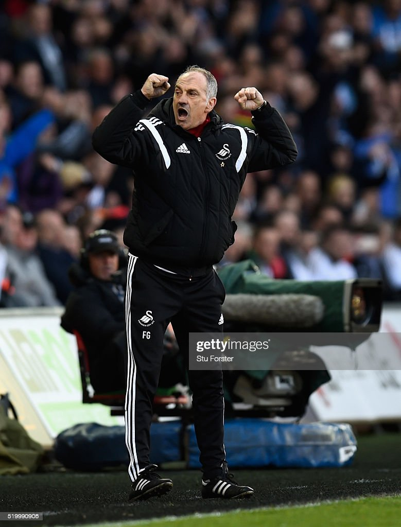 Swansea head coach Francesco Guidolin reacts on the final whistle after the Barclays Premier League match between Swansea City and Chelsea at Liberty Stadium on April 9, 2016 in Swansea, Wales.
