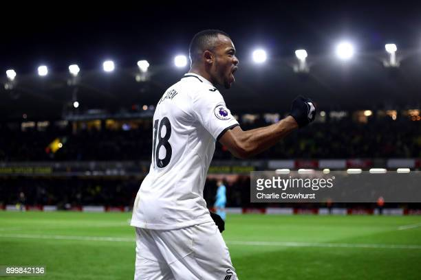 Swansea Jordan Ayew celebrates the teams after the final whistle during the Premier League match between Watford and Swansea City at Vicarage Road on...