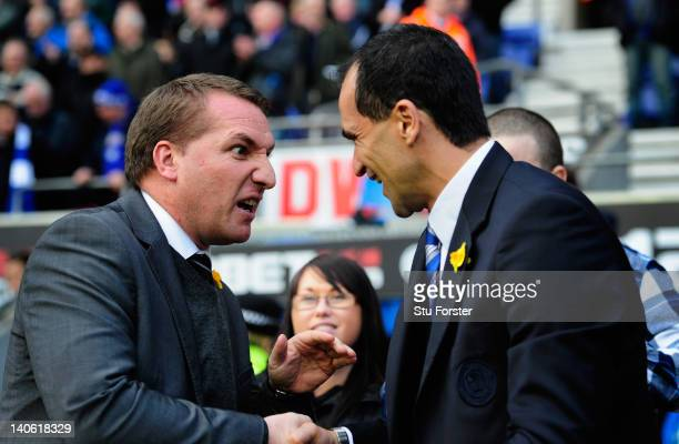 Swansea manager Brendan Rodgers greets his Wigan counterpart Roberto Martinez before the Barclays Premier League match between Wigan Athletic and...