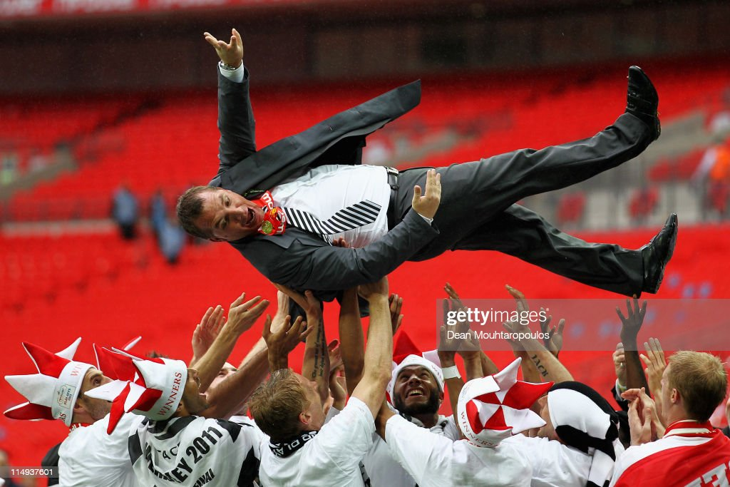 Swansea Manager, Brendan Rodgers is thrown in the air by his players after winning the npower Championship Playoff Final between Reading and Swansea City at Wembley Stadium on May 30, 2011 in London, England.