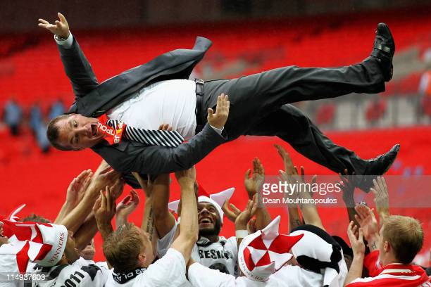 Swansea Manager Brendan Rodgers is thrown in the air by his players after winning the npower Championship Playoff Final between Reading and Swansea...