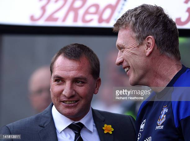 Swansea Manager Brendan Rodgers talks with Everton Manager David Moyes during the Barclays Premier League match between Swansea City and Everton at...