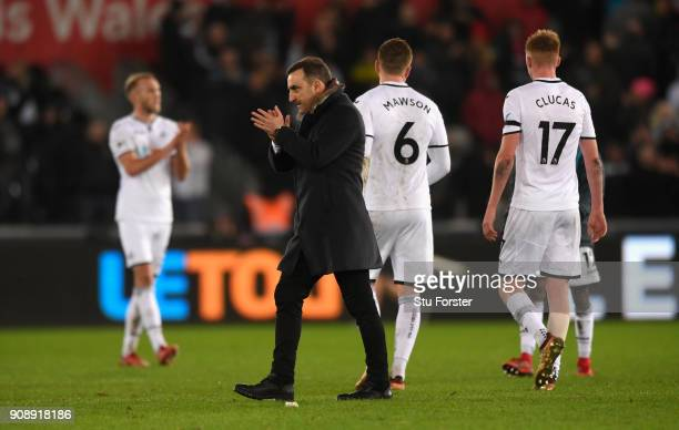 Swansea manager Carlos Carvalhal applauds the fans after the Premier League match between Swansea City and Liverpool at Liberty Stadium on January 22...