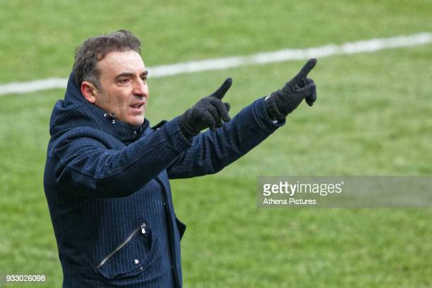Swansea manager Carlos Carvalhal asks the assistant referee to check VAR after the goal scored by Christian Eriksen of Tottenham Hotspur during the...