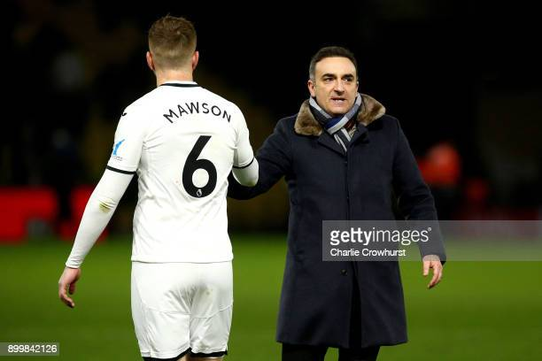 Swansea Manager Carlos Carvalhal celebrates the teams win with Alfie Mawson after the final whistle during the Premier League match between Watford...