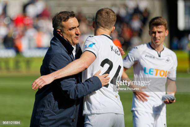 Swansea manager Carlos Carvalhal embraces Andy King of Swansea City after the end of the game during the Premier League match between Swansea City...