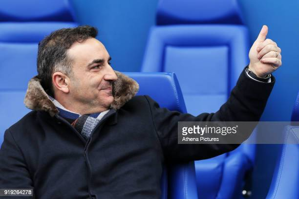 Swansea manager Carlos Carvalhal gives the thumbs up to a home supporter from the bench during The Emirates FA Cup Fifth Round match between...