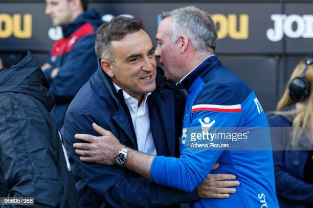 Swansea manager Carlos Carvalhal greets Stoke City manager Paul Lambert prior to the game during the Premier League match between Swansea City and...