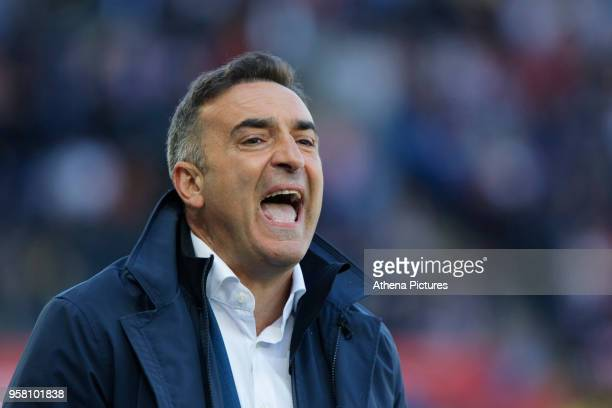 Swansea manager Carlos Carvalhal shouts instructions to his players from the touch line during the Premier League match between Swansea City and...