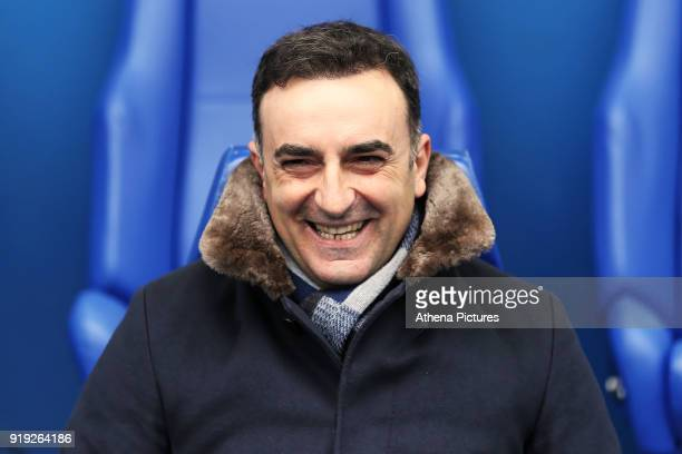 Swansea manager Carlos Carvalhal sits on the bench during The Emirates FA Cup Fifth Round match between Sheffield Wednesday and Swansea City at...