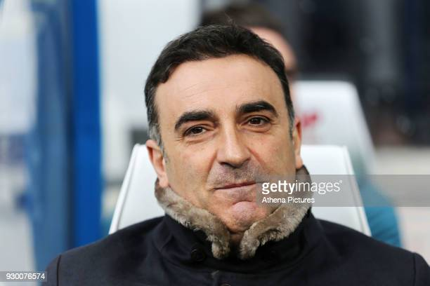 Swansea manager Carlos Carvalhal sits on the bench during the Premier League match between Huddersfield Town and Swansea City and at the John Smith's...