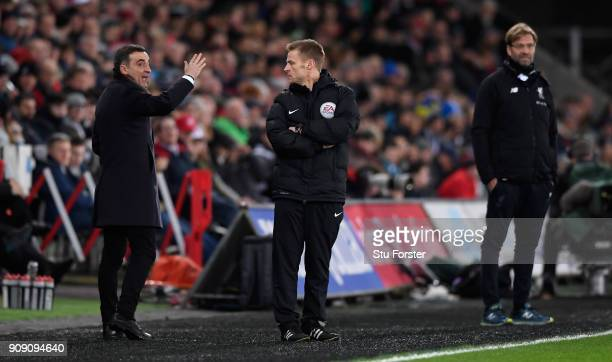 Swansea manager Carlos Carvalhal speaks with fourth official Michael Jones during the Premier League match between Swansea City and Liverpool at...