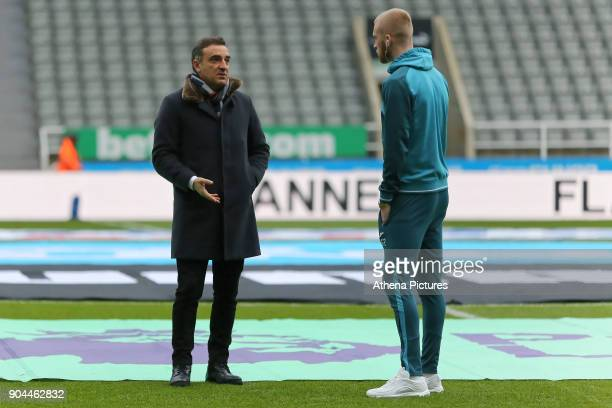 Swansea manager Carlos Carvalhal speaks with Oliver McBurnie of Swansea City prior to the game during the Premier League match between Newcastle...