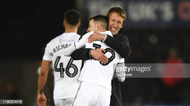 Swansea manager Graham Potter congratulates Bersant Celina after the FA Cup Fifth Round match between Swansea and Brentford at Liberty Stadium on...