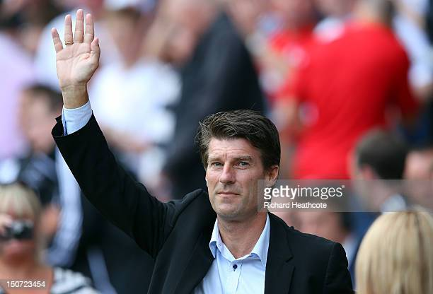 Swansea manager Michael Laudrup waves to the crowd during the Barclays Premier League match between Swansea City and West Ham United at the Liberty...