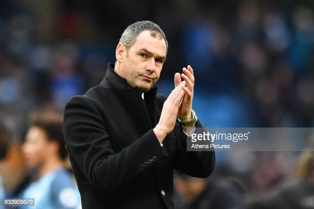 Swansea manager Paul Clement applauds the Swansea fans at full time during the Premier League match between Manchester City and Swansea City at the...