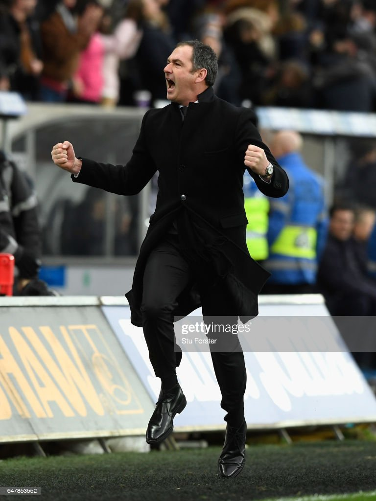 Swansea manager Paul Clement celebrates the winning goal by running down the touchline during the Premier League match between Swansea City and Burnley at Liberty Stadium on March 4, 2017 in Swansea, Wales.