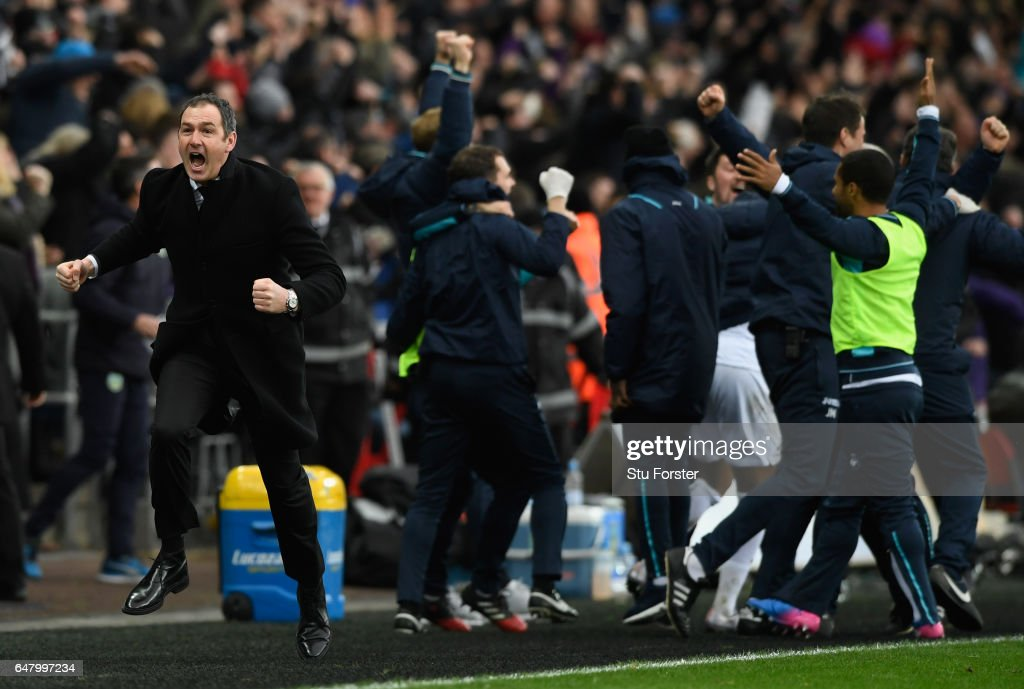 Swansea manager Paul Clement celebrates the winning goal by setting off on a run down the touchline during the Premier League match between Swansea City and Burnley at Liberty Stadium on March 4, 2017 in Swansea, Wales.
