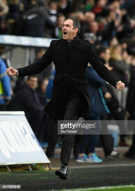 Swansea manager Paul Clement celebrates the winning goal by setting off on a run down the touchline during the Premier League match between Swansea...