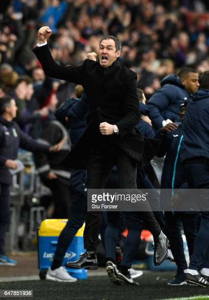 Swansea manager Paul Clement celebrates the winning goal with his staff during the Premier League match between Swansea City and Burnley at Liberty...