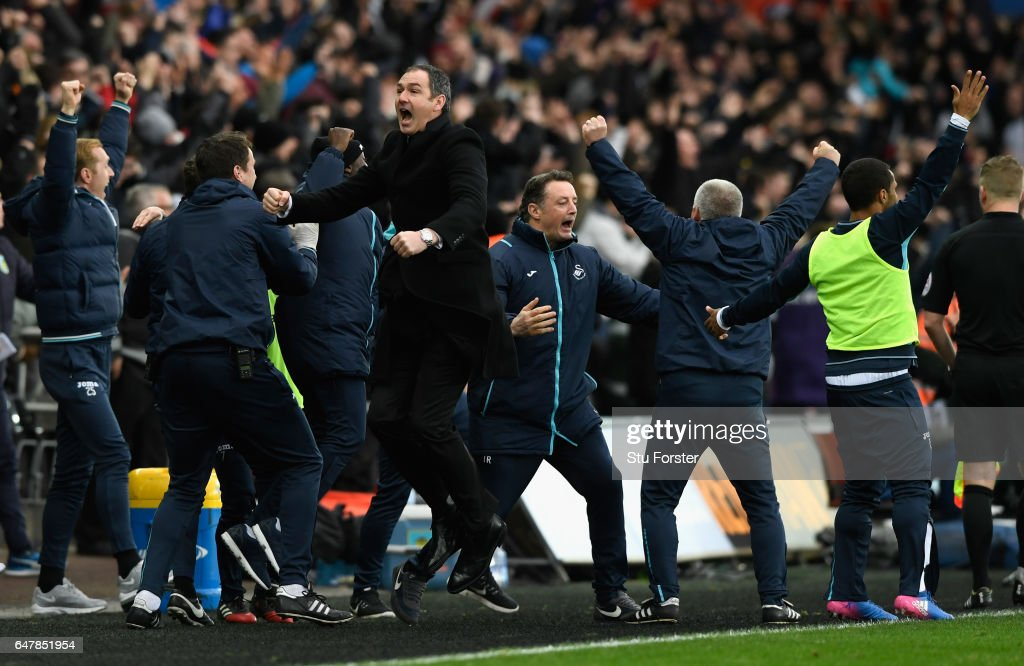 Swansea manager Paul Clement celebrates the winning goal with his staff during the Premier League match between Swansea City and Burnley at Liberty Stadium on March 4, 2017 in Swansea, Wales.