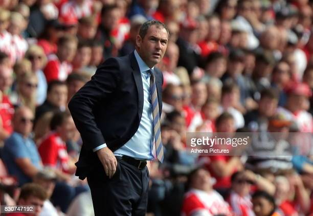 Swansea manager Paul Clement looks towards his away fans during the Premier League match between Southampton and Swansea City at the St Mary's...