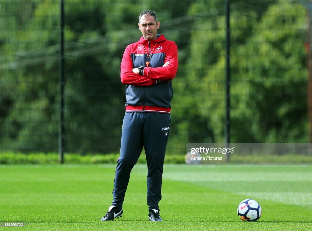 Swansea manager Paul Clement observes his players training during the Swansea City Training and Press Conference at The Fairwood Training Ground on August 24, 2017 in Swansea, Wales.