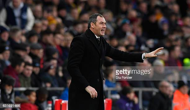 Swansea manager Paul Clement reacts during the Premier League match between Swansea City and Arsenal at Liberty Stadium on January 14 2017 in Swansea...