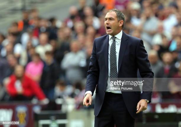 Swansea manager Paul Clement shouts instructions to his players during the Premier League match between West Ham United v Swansea City at the London...