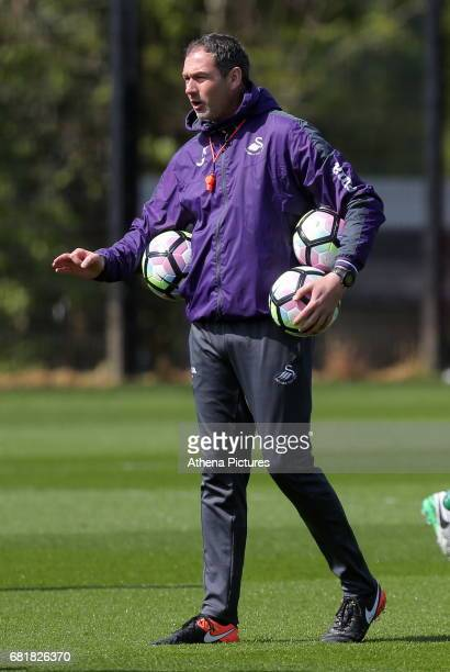 Swansea manager Paul Clement speaks to his players during the Swansea City Training at The Fairwood Training Ground on May 10 2017 in Swansea Wales