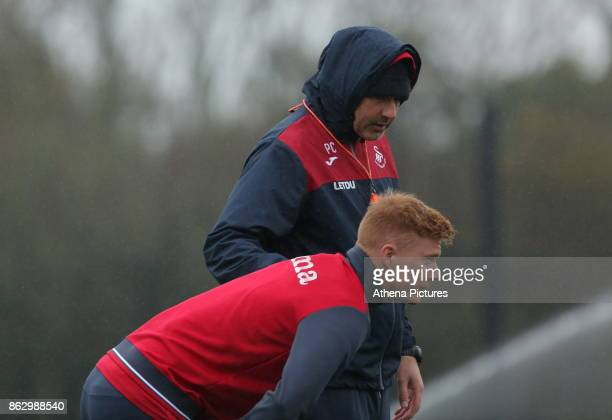 Swansea manager Paul Clement speaks to Sam Clucas during the Swansea City Training at The Fairwood Training Ground on October 18 2017 in Swansea Wales