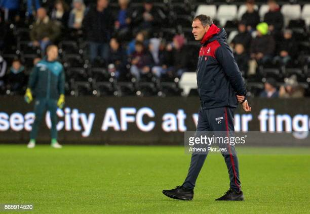 Swansea manager Paul Clement watches his players warm up prior to the Carabao Cup Fourth Round match between Swansea City and Manchester United at...