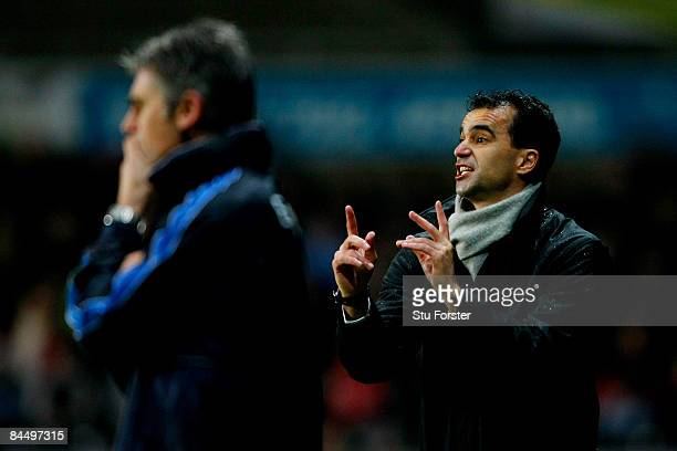 Swansea manager Roberto Martinez makes a point as Preston manager Alan Irvine looks on during the Coca Cola Championship match between Swansea City...