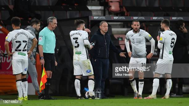 Swansea manager Steve Cooper talks to his players in an injury break during the Sky Bet Championship match between AFC Bournemouth and Swansea City...