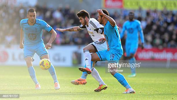 Swansea player Alejandro Pozuelo tangles with Mousa Dembele of Spurs during the Barclays premier league match between Swansea City and Tottenham...